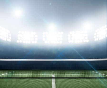 tennis stadium: A tennis court in an arena with a marked green hard surface at night under illuminated floodlights