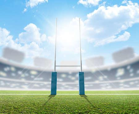 푸른 하늘 아래 낮에 표시된 녹색 잔디 경기장에서 럭비 게시물과 함께 럭비 경기장 스톡 콘텐츠