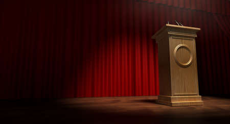 debates: A regular theater stage with closed red curtains and a wooden debate podium lit by a single spotlight Stock Photo