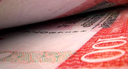 inbetween: A macro close-up view showing the detail inbetween two separated hong kong dollar banknotes