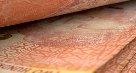 inbetween: A macro close-up view showing the detail inbetween two separated south african rand banknotes Stock Photo