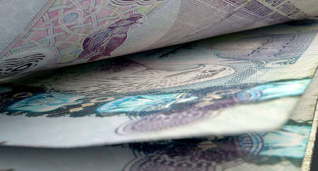inbetween: A macro close-up view showing the detail inbetween two separated dirham banknotes Stock Photo