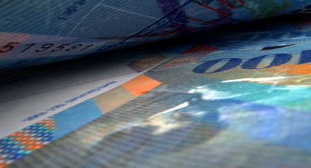inbetween: A macro close-up view showing the detail inbetween two separated swiss franc banknotes Archivio Fotografico