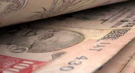 inbetween: A macro close-up view showing the detail inbetween two separated indian rupee banknotes