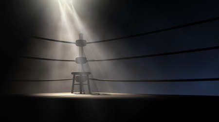 boxing sport: A dramatic view of the corner of an old vintage boxing ring with an empty stool spotlit by a single spotlight on an isolated dark background