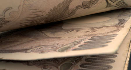inbetween: A macro close-up view showing the detail inbetween two separated japanese yen banknotes