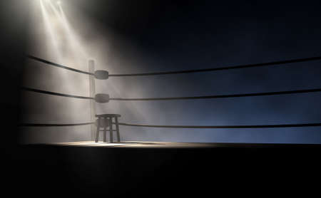 A dramatic view of the corner of an old vintage boxing ring with an empty stool spotlit by a single spotlight on an isolated dark background