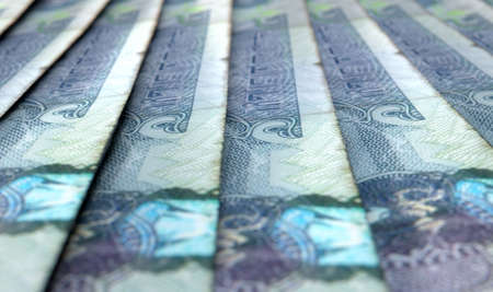 A macro close-up view showing the detail of dirham banknotes laid out and overlapping in a staggered row photo