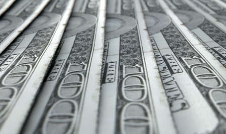 staggered: A macro close-up view showing the detail of us dollar banknotes laid out and overlapping in a staggered row Stock Photo