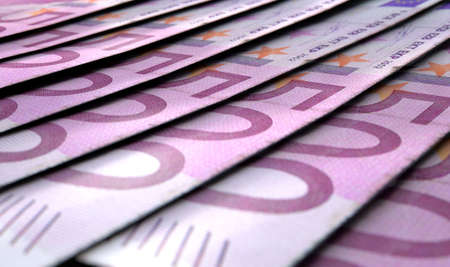 staggered: A macro close-up view showing the detail of european euro banknotes laid out and overlapping in a staggered row Stock Photo