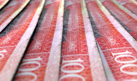 staggered: A macro close-up view showing the detail of malaysian hong kong dollar banknotes laid out and overlapping in a staggered row