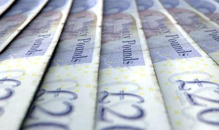 libra esterlina: Una vista de primer plano macro que muestra el detalle de los billetes en libras británicas distribuido y superposición en una fila escalonada