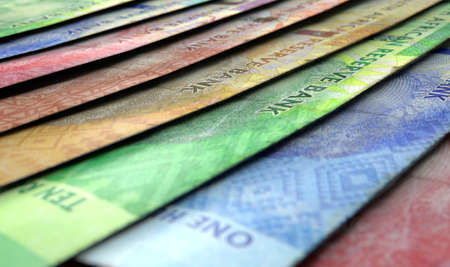 rand: A macro close-up view showing the detail of south african rand banknotes laid out and overlapping in a staggered row Stock Photo