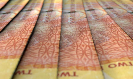 staggered: A macro close-up view showing the detail of south african rand banknotes laid out and overlapping in a staggered row Stock Photo