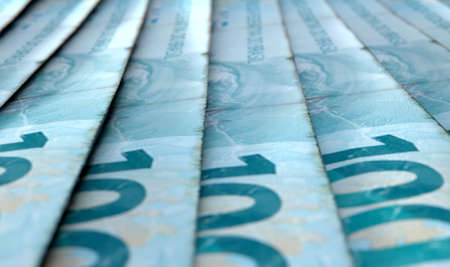 staggered: A macro close-up view showing the detail of brazilian real banknotes laid out and overlapping in a staggered row