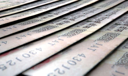 staggered: A macro close-up view showing the detail of indian rupee banknotes laid out and overlapping in a staggered row Stock Photo