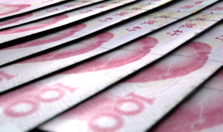 staggered: A macro close-up view showing the detail of chinese yuan banknotes laid out and overlapping in a staggered row