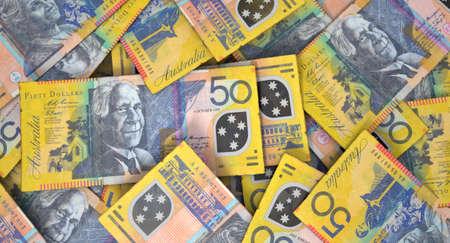 australian dollar notes: A macro close-up view of a messy scattered pile of australian dollar banknotes