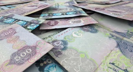 dirham: A macro close-up view of a messy scattered pile of dirham banknotes