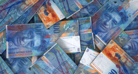 swiss franc: A macro close-up view of a messy scattered pile of swiss franc banknotes