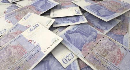 libra esterlina: Una vista de primer plano macro de una pila sucia dispersa de billetes en libras británicas Foto de archivo