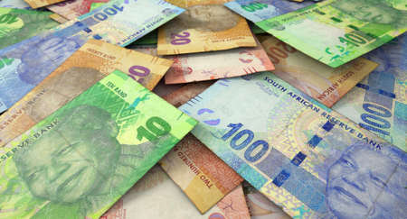 bank notes: A macro close-up view of a messy scattered pile of south african rand banknotes