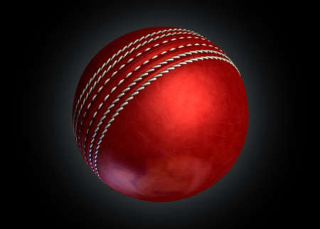 cricket ball: A regular red leather cricket ball on an isolated dark background