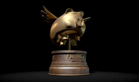 against all odds: A gold trophy of a mythical flying pig on top of a wooden base and a description which reads above and beyond on an isolated dark studio background Stock Photo