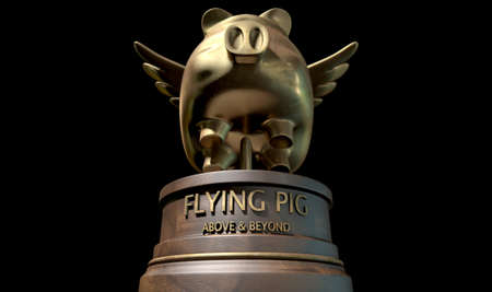 pig wings: A gold trophy of a mythical flying pig on top of a wooden base and a description which reads above and beyond on an isolated dark studio background Stock Photo