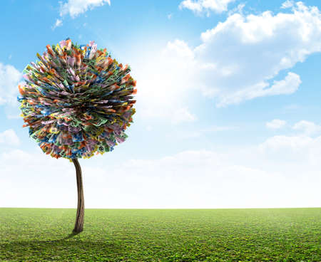 money tree: A stylized fantasy mythical australian dollar money tree on a green lawn and blue sky backgroud Stock Photo