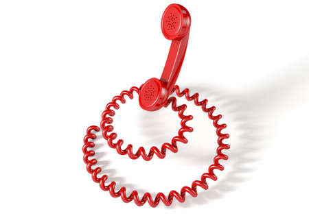 coiled: A vintage telephone handset connected to a coiled cord shaped like a spiral on an isolated white studio background