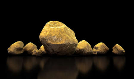 goldmine: A collection of gold nuggets on an isolated dark background Stock Photo