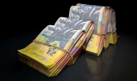 doubled: A close-up view of five wads of folded over stacks of australian dollar banknotes each bound infomally by a rubber band set out in a domino formation on an isolated dark studio background Stock Photo