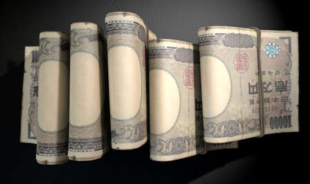 doubled: A close-up view of five wads of folded over stacks of japanese yen banknotes each bound infomally by a rubber band set out in a domino formation on an isolated dark studio background