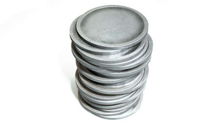 coin silver: An extreme closeup of a stack of blank silver coins on an isolated white studio background