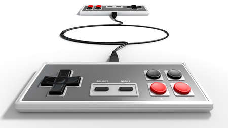 opposing: Two opposing vintage rectangular gaming controllers connected by their cords on an isolated studio background Stock Photo