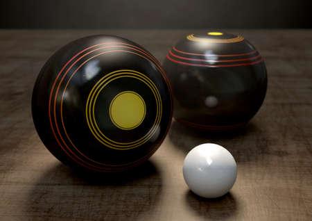 biased: Due sfere di legno prato bowling che circondano una presa bianca su uno sfondo di legno isolato dello studio scuro Archivio Fotografico