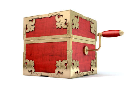 surprise box: An ornate antique closed jack-in-the-box mad of red wood and gold trimmings on an isolated white studio background