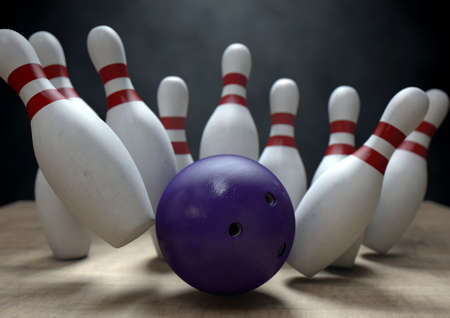 struck: An arrangement of white and red used vintage bowling pins being struck by a bowling ball on a wooden bowling alley surface on a dark background Stock Photo