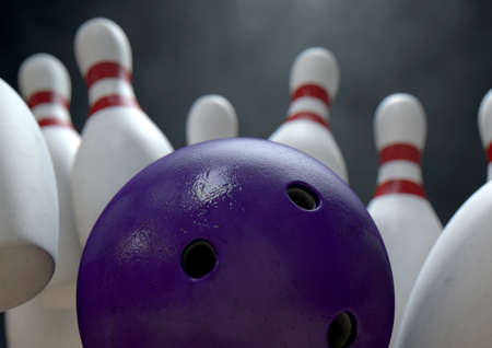 bowling strike: An arrangement of white and red used vintage bowling pins being struck by a bowling ball on a wooden bowling alley surface on a dark background Stock Photo