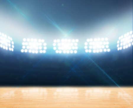 baloncesto: Un Gynasium cubierta con un suelo de madera sin marcar iluminados con luz artificial