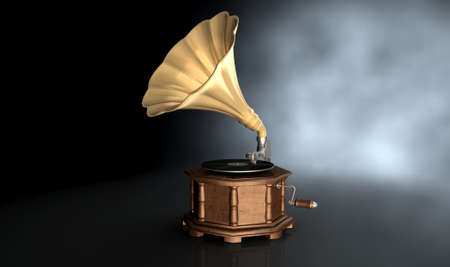 antique phonograph: An old brass and wood gramophone with a vinyl record on it on an isolated dark background Stock Photo