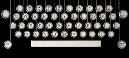 typewriter: An extreme close up of the keys of a vintage typwriter on a dark background