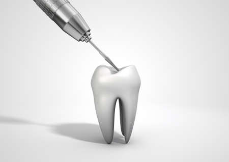 dental fear: A closeup of a steel dentists drill probe performing an examination on a single  tooth on an isolated studio background Stock Photo