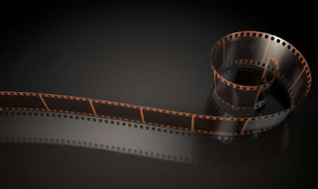 curled up: A strip of blank old vintage camera film curled up on an isolaed studio background Stock Photo