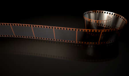 curled: A strip of blank old vintage camera film curled up on an isolaed studio background Stock Photo