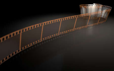 35mm: A strip of blank old vintage camera film curled up on an isolaed studio background Stock Photo