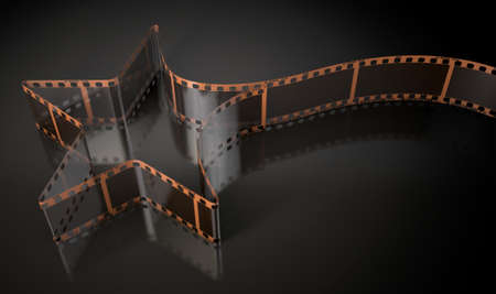 film shooting: A strip of blank old vintage camera film curled into the shape of a shooting star on an isolaed studio background