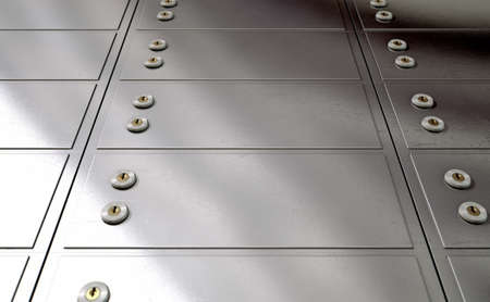 deposit: A closeup of a wall of closed metal safety deposit boxes