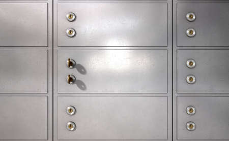 deposit: A closeup of a wall of closed metal safety deposit boxes and one with two keys inserted into it
